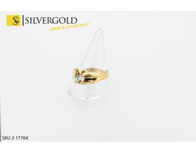 Anillo tipo solitario con brillo central. Oro 18 kt